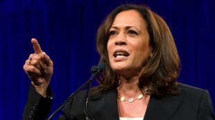 Kamala Harris speaking at the DNC on the podium