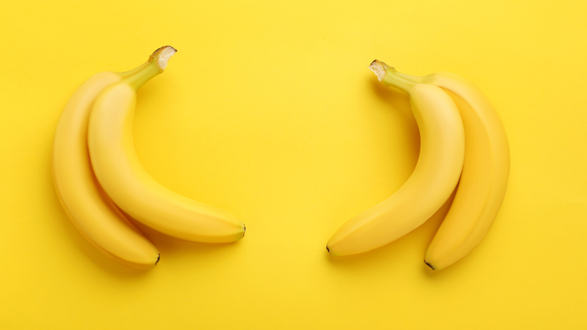 Two Bananas on a Yellow Background