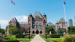 The Legislative Assembly of Ontario at Queens park on a sunny day