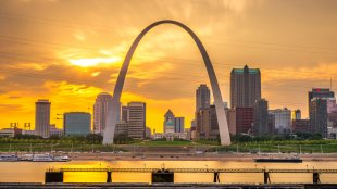 Downtown St.Louis, Missouri on the Mississippi River at sunset