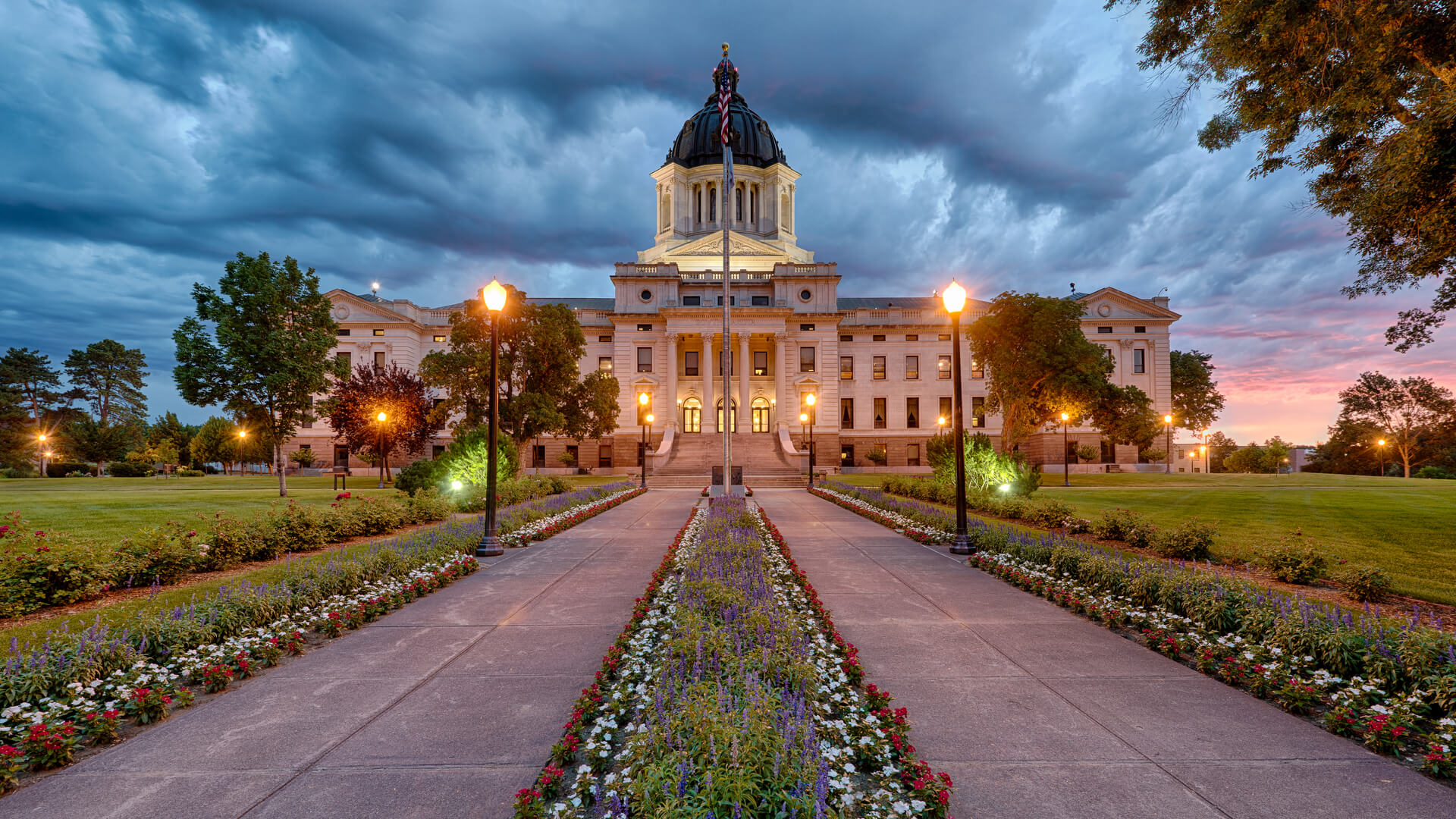 South Dakota State Capitol building in Pierre, South Dakota with a storm in the background