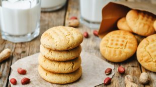 peanut butter cookies on a dark wood background