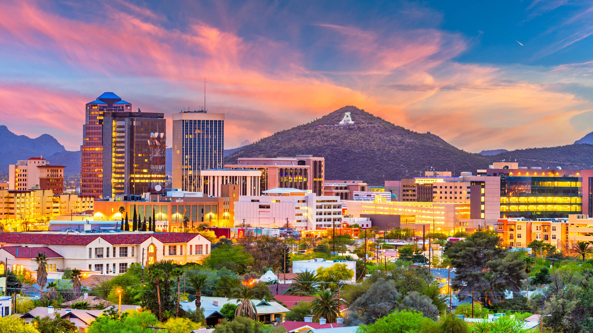 A shot of the Tucson Arizona downtown skyline with Sentinel Peak at dusk