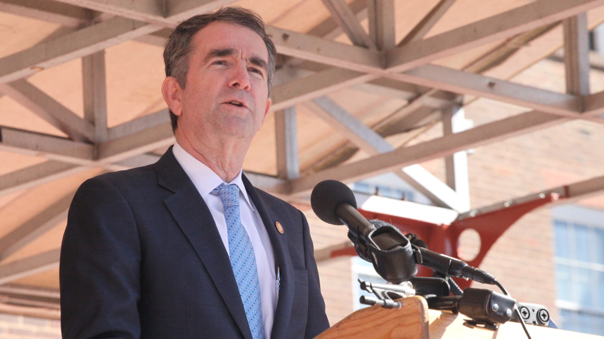 Virginia Governor, Ralph Northam speaking in front of Alexandria City Hall