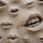 Closeup of mouths on a sand sculpture