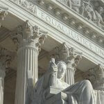 Closeup of the Equal Justice Under Law engraving above entrance to US Supreme Court Building