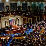 Members of congress mingle on the house floor